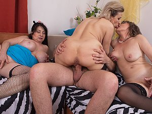 Two Milfs and a grandma share a toyboy's big cock during groupsex